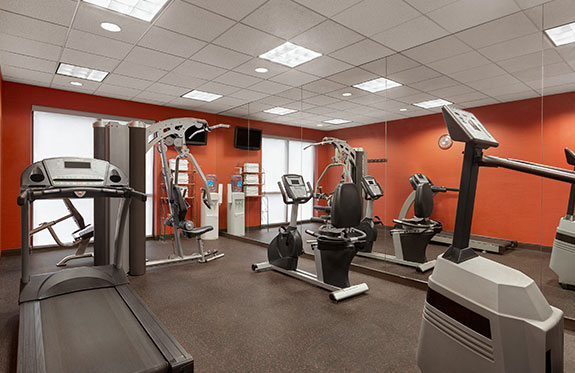 fitness center with the latest modern equipment on the first floor