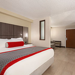 Ramada Orlando king executive suites have white bathtubs and showers