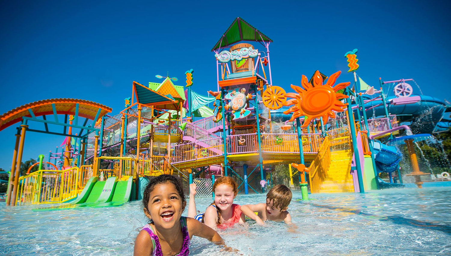 water theme park with kids swimming in the pool