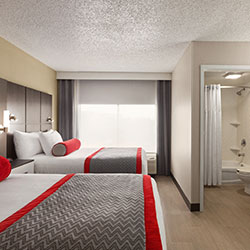 red twin beds while enjoying all comforts in a luxurious hotel suites